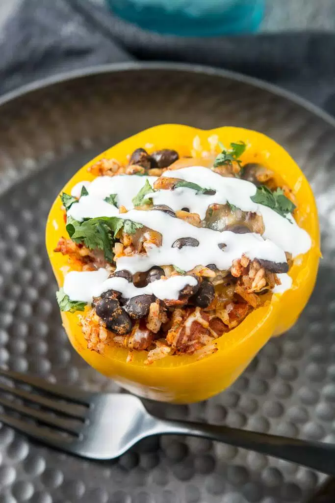 4 - Slow Cooker Stuffed Peppers via Slow Cooker Gourmet