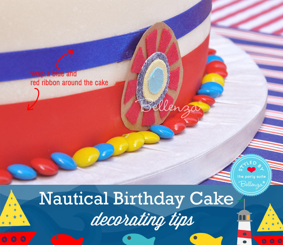 Add blue and red ribbons to the nautical birthday cake