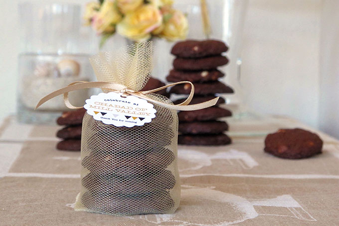 #1 White chocolate chip cookies packaged in tulle wrapping with ribbon and scalloped favor tag via Evermine.