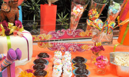 Colorful candy table with a circus theme. Photo by Bellenza.