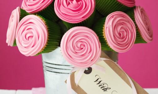 Pink cupcake centerpiece. Photo credit: Punch Bowl
