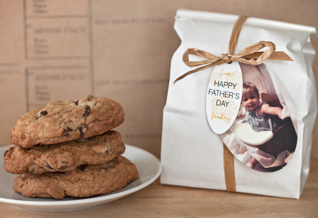 #4 Chocolate chip cookies packaged in a white paper bag with a small oval tag, customized photo tag, and raffia tie for Father's Day from Evermine.