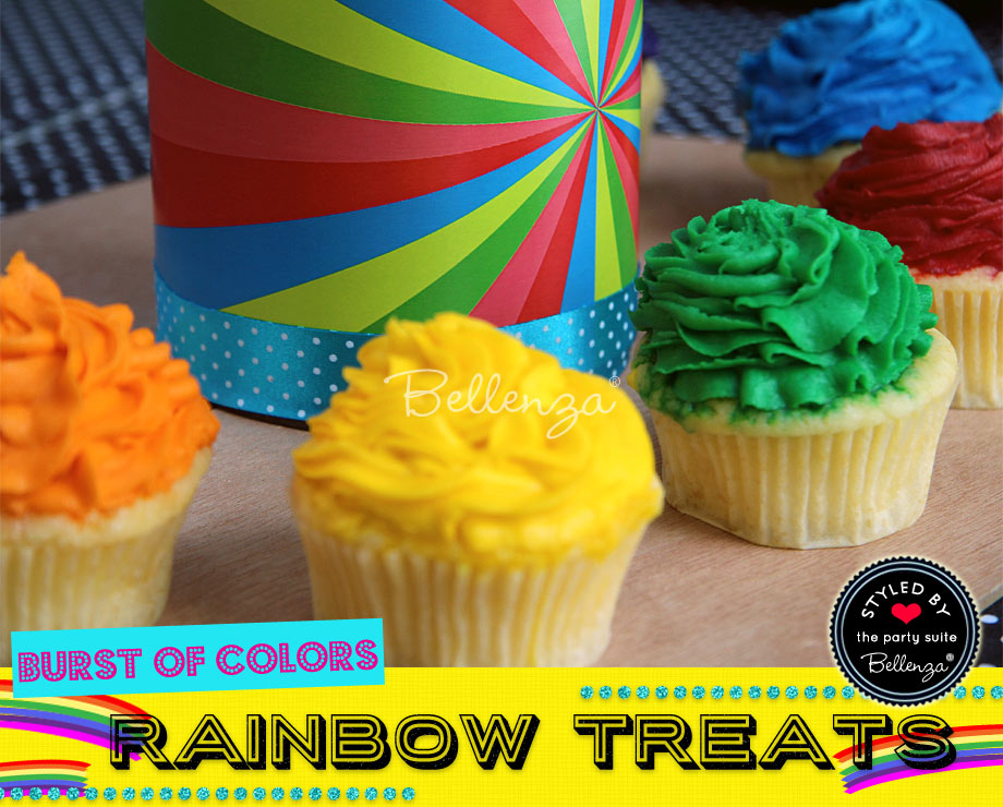 Colorful cupcakes in green, yellow, orange, red, and blue.