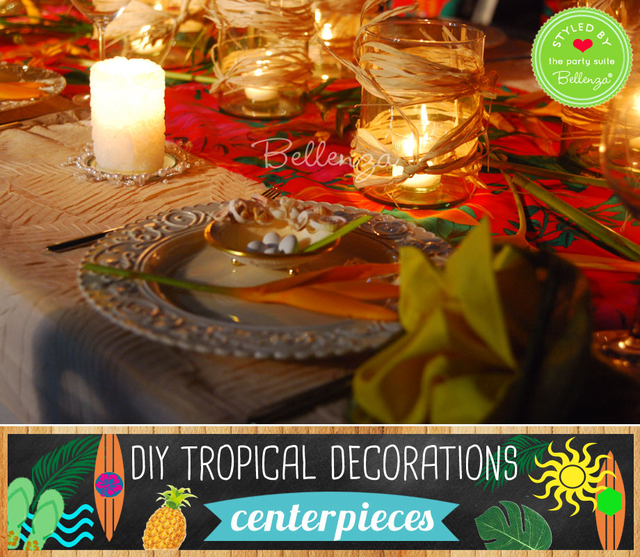 Tropical centerpieces made of raffia, red tablecloth, candles, and leaves.