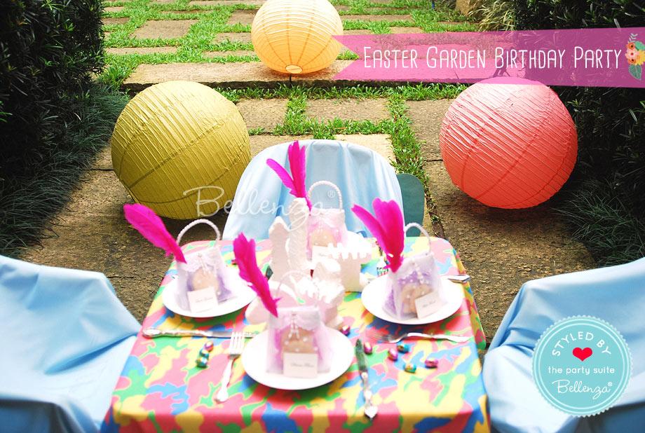Butterflies and fairies children's tea party tablescape in a garden.