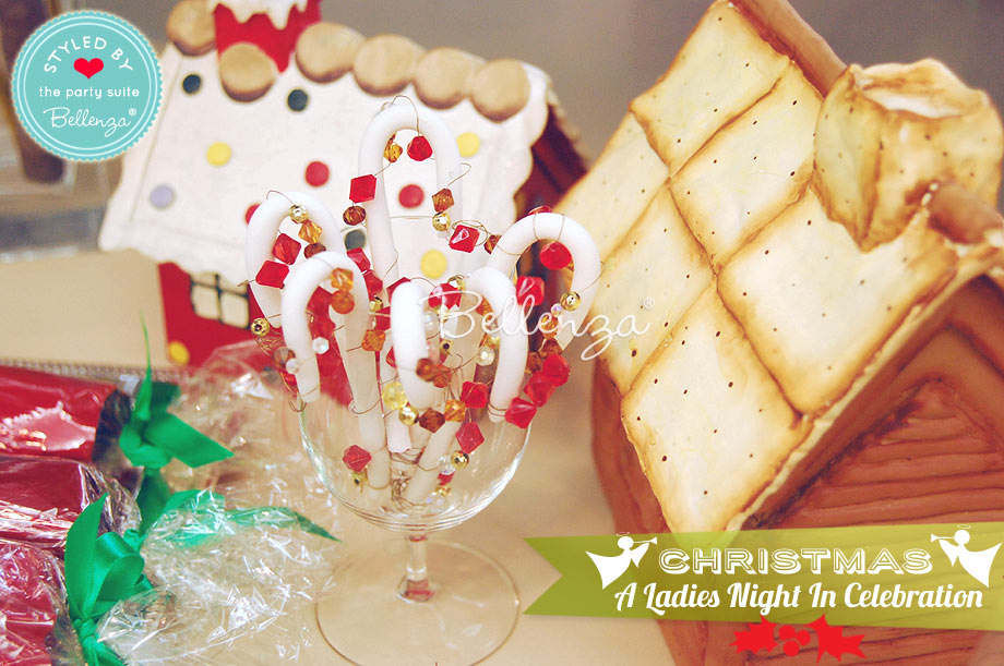Gingerbread house, peppermint sticks, and red party crackers