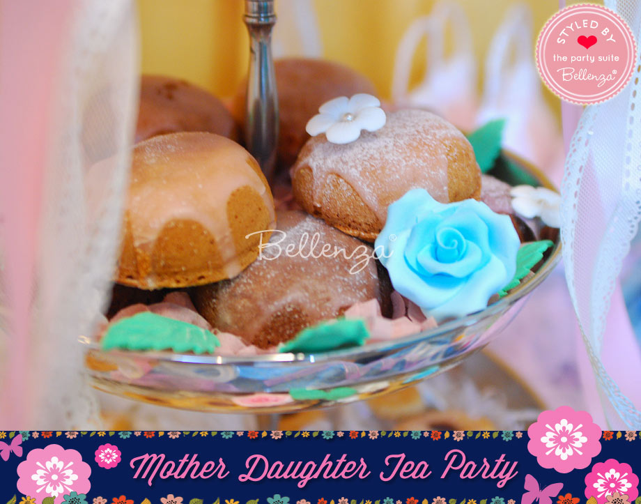 Frosted bundt cakes with sugar flowers for a mommy and me tea party