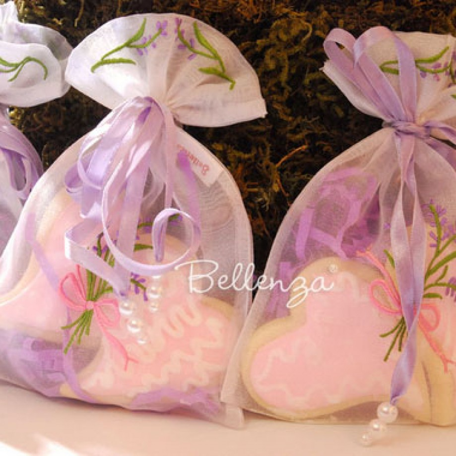 Organza pouches with sugar cookies for Mother's Day tea party favors.