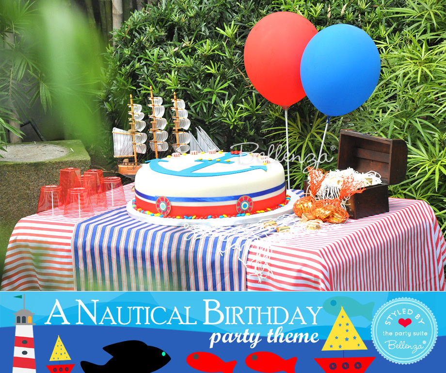 Nautical themed cake and sweets table for kids with balloons.