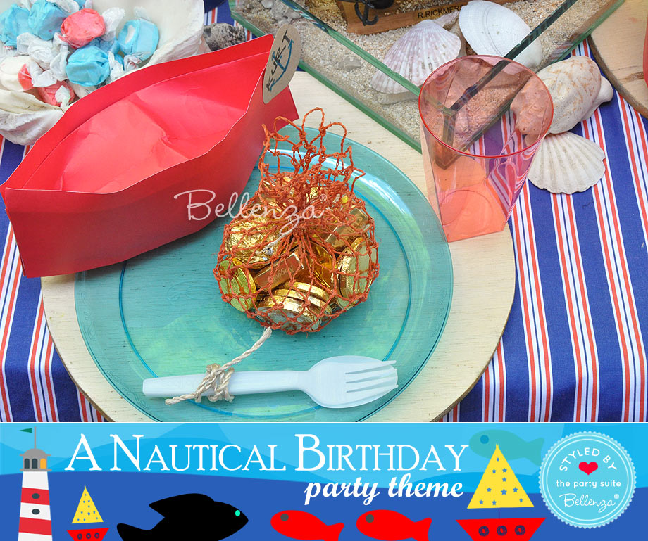 Nautical party favors consisting of chocolates in nets.