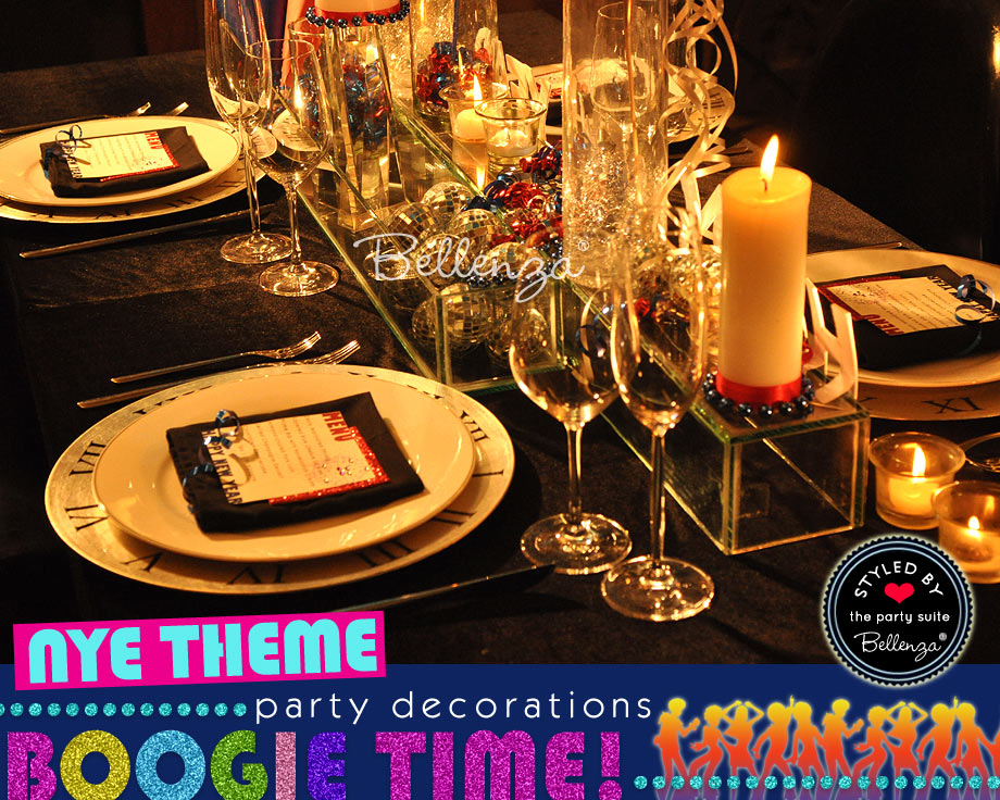 NYE Disco Tablescape with disco balls, candles, and clock plate chargers