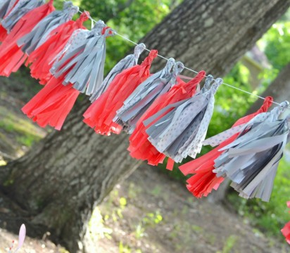 Red and gray tissue paper tassel garland. Photo by A Reason to Get Together