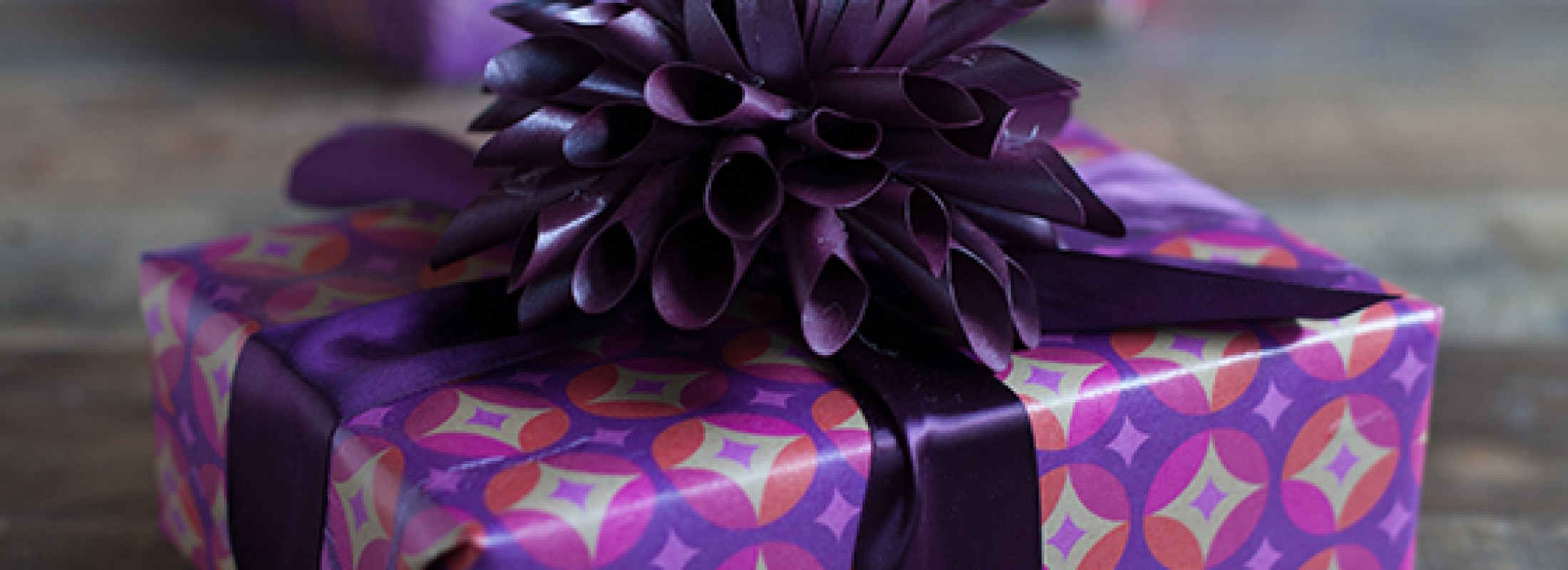 glamorous holiday gift packaging in pretty purple and fuchsia