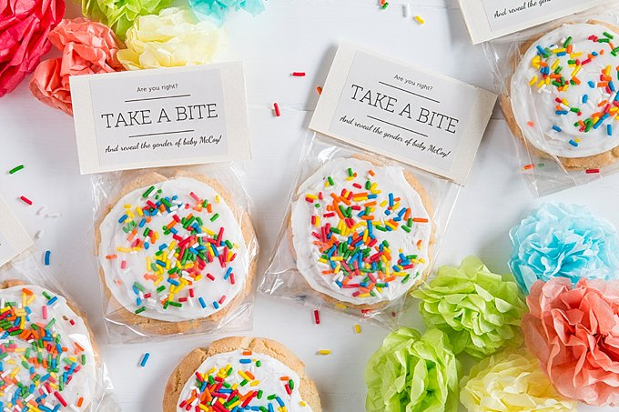 "#14 Gender reveal sugar cookies in simple cello bags with a personalized label that says ""take a bite"" from Evermine."