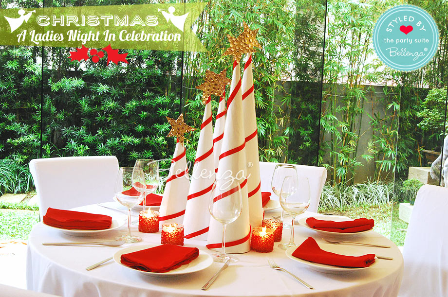 Red and white table decorations for a Christmas Ladies Night In