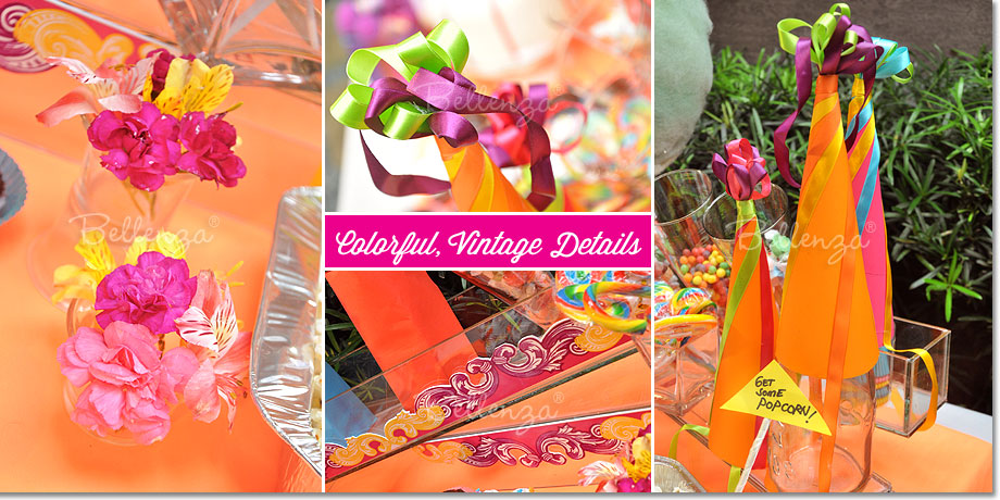 Colorful accents, flowers, and paper cone hats as decorations for a circus theme candy table