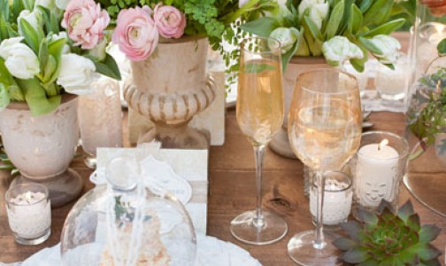 Antique candelabra and vintage teacups via Exquisite Weddings Magazine