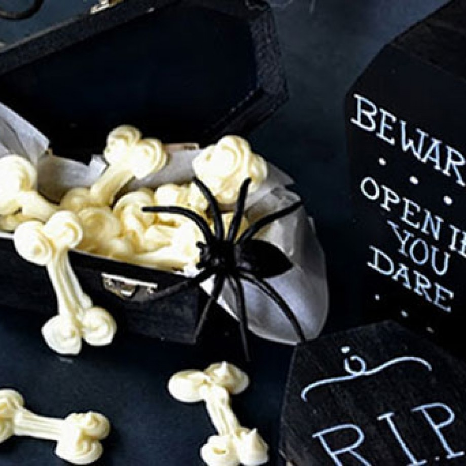 White chocolate bones in a black mini coffin