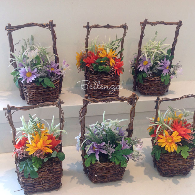 Faux spring flowers in baskets favors