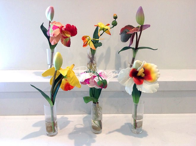 Ladies luncheon favors - orchids in glass vases