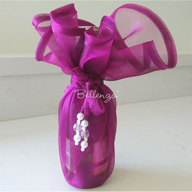 Fuchsia organza wine bottle wrap.