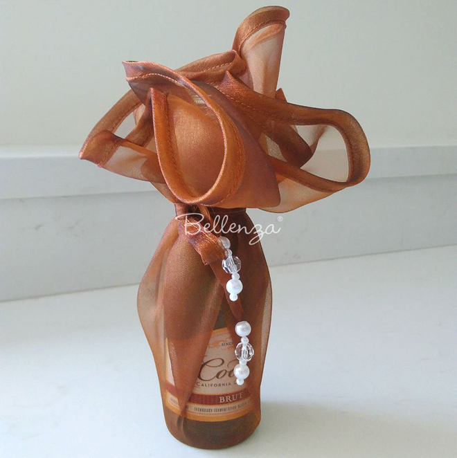 fall wine bottles in fabric wrapping