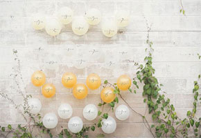Yellow and white balloons table numbers