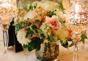 Floral centerpiece with gold goblets