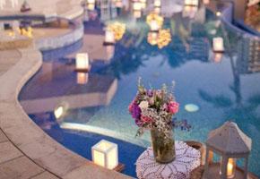 Wedding lanterns by a pool reception