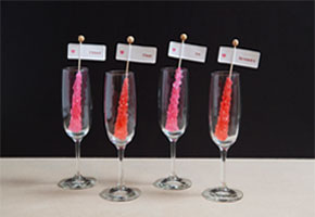 Rock candy place cards in glass