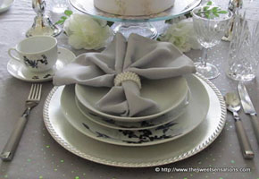 A Silver and White Wedding Table by Sweet Sensations