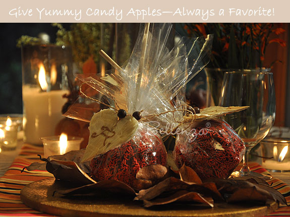 Candy apples in chocolate and orange sprinkles