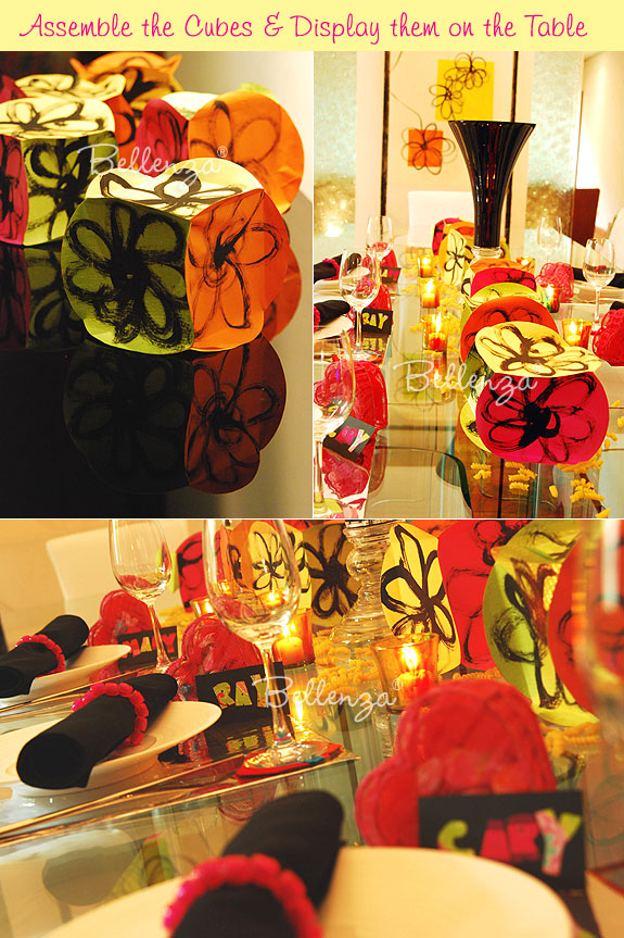 Table centerpiece display on black, hot pink, yellow, and green palette