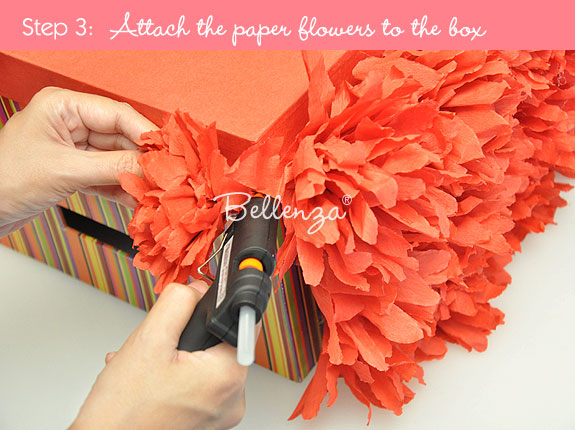 Attach rose paper flowers on box
