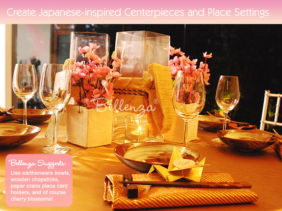 Cherry blossom accents in chopsticks, crane place cards, and Japanese style place setting