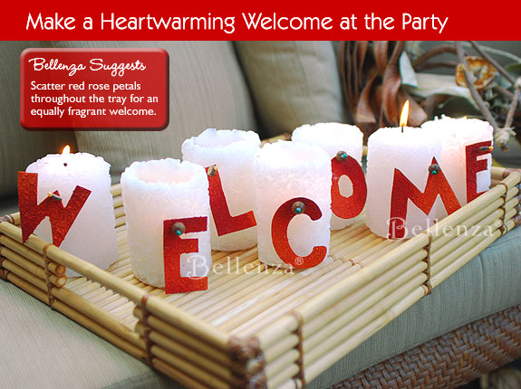 Red welcome letters on white candles.