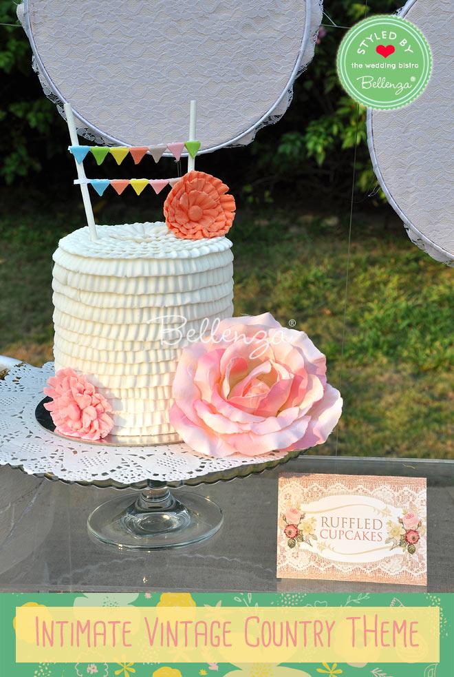 Vanilla cream ruffled wedding cake with pink peonies and mini cake bunting.