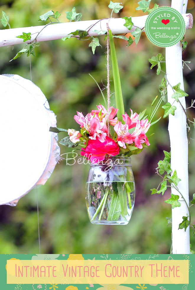 Floating roses in glass vases for a vintage country wedding