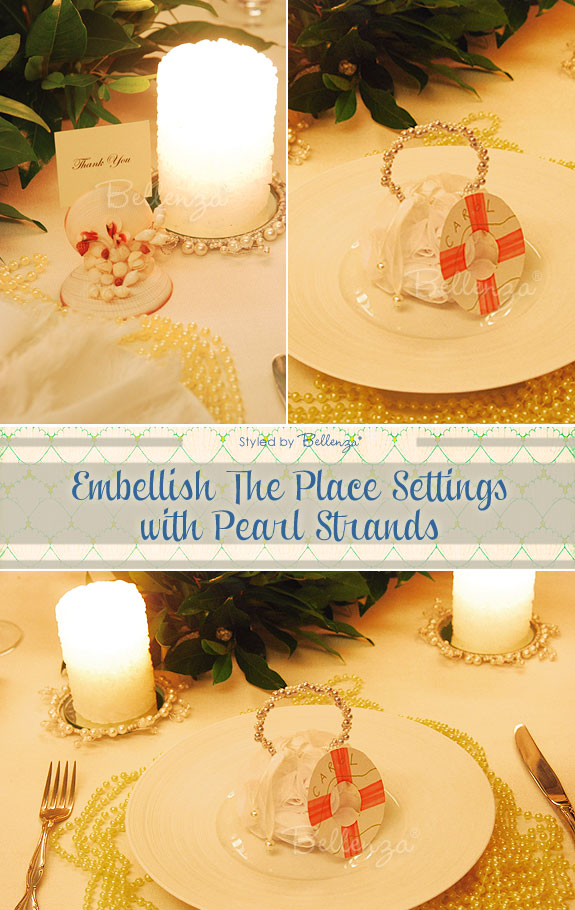 Pearl decorated place settings with candles