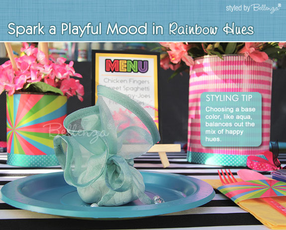 Aqua table with a mix of colors makes for a fun rehearsal dinner tablescape.