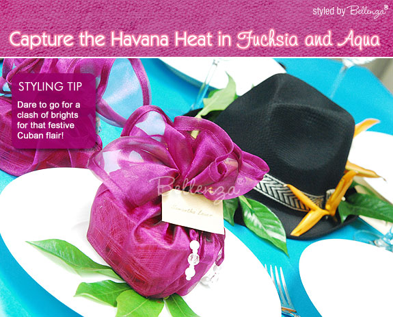 Bring bold fuchsia and brightly color accents for a hot summer Havana rehearsal dinner party.