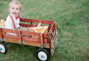 Ring bearer on wagon via Southern Weddings