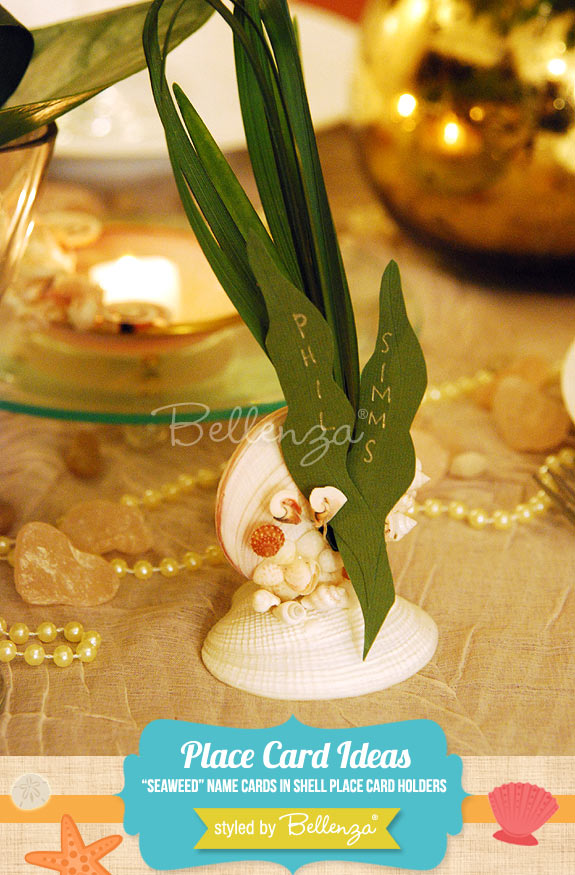 Seaweed cut-outs of name cards in seashell place card holders