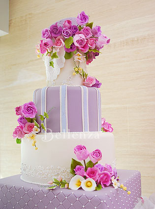 A grand pink and lilac bridal shower cake in honor of the bride