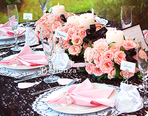 Mini gown favor on black and pink tablescape for a vintage bridal shower