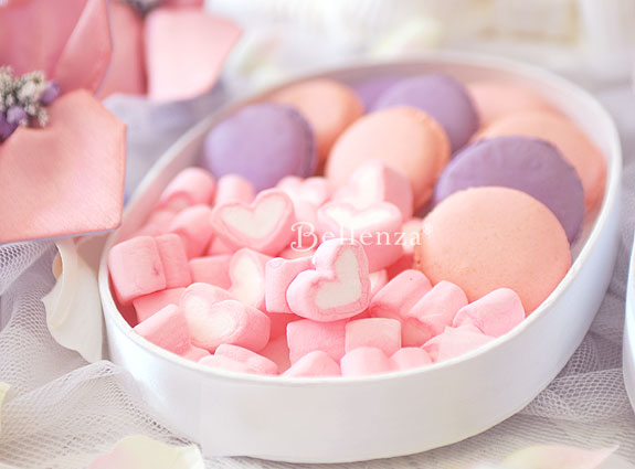 Pink confections in oval boxes.