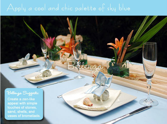 Beach inspired tablesetting with orange and pale blue.