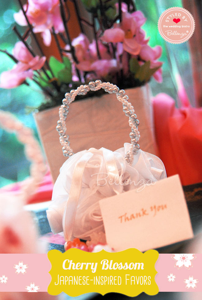 Floral white favor bags with konpeito sugar candies.