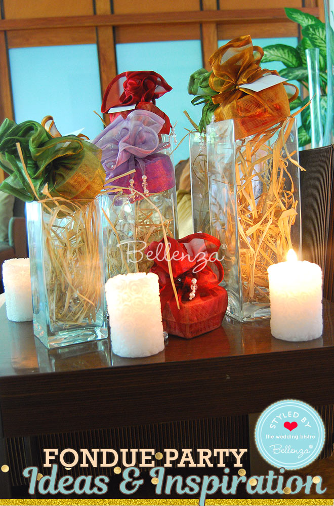 Fondue party favors presented on glass vases with candles // Bellenza