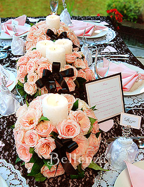Rose ball shaped centerpiece in pink and white candles